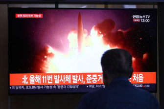 People watch a TV showing an image of a North Korean missile launch at Seoul Railway Station on October 2, 2019.