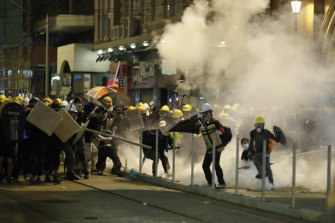 Police fire tear gas at protesters in Hong Kong on Sunday night.