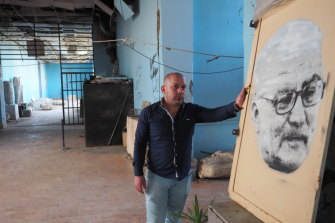 Tarek al-Asaad with the portrait of his late father, Khaled, by Sydney artist Luke Cornish.