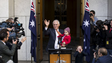 Malcolm Turnbull with granddaughter Alice and grandson Jack after speaking to the media on Friday.