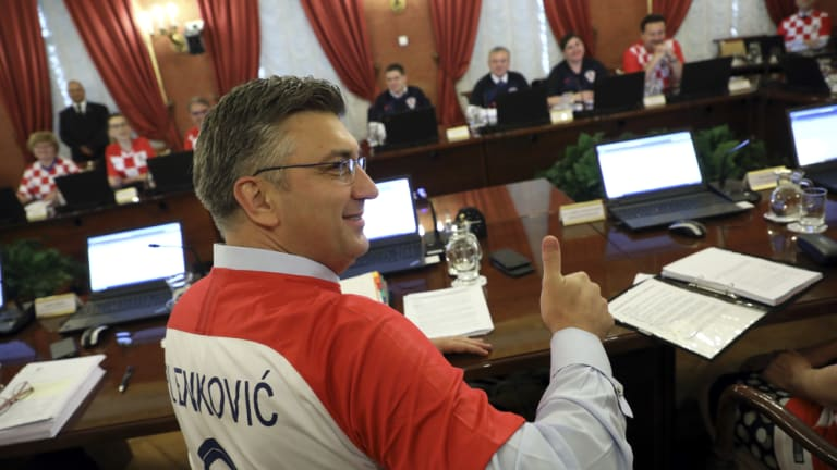 Photo opportunity: Croatia's prime minister Andrej Plenkovic, and cabinet ministers, wear national team jerseys during a government session in Zagreb.
