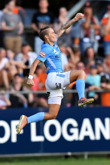 Full flight: Jessica Fishlock celebrates after putting City 2-0 up against the Roar.