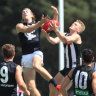 Adam Treloar goes for a mark in their JLT Series match against Carlton in Moe.