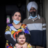 """Harmeet Bedi, Sarabjeet Singh and five-year-old Beeneet Kaur say they feel like """"sitting ducks""""."""