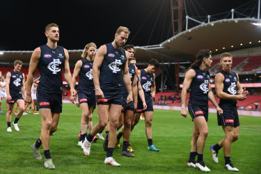 Carlton leave the field after losing to GWS.