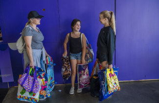 Maria Apostolatos, left, with daughter Zoe and friend Eleni Kay spent over $300 on showbags.