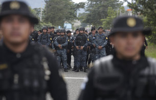 Guatemalan police block the road   near Esquipulas, Guatemala on Monday.