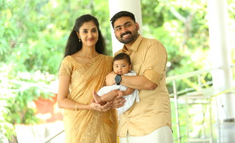 Roby Varghese and wife Juna Devasia and baby Tessa.