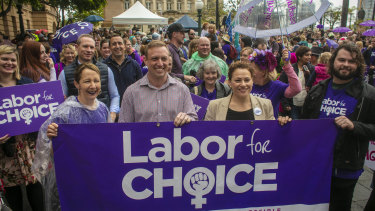 Health Minister Steven Miles (second from left) and Deputy Premier Jackie Trad (third from left) are seen attending the March Together for Choice rally in Brisbane ahead of proposed changes to Queensland's abortion laws.