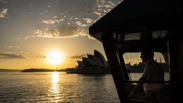 """""""It's a beautiful harbour of a morning"""": ferry master Charlie Johnston, who starts his day with a 3am alarm, on the first ferry out of Barangaroo."""