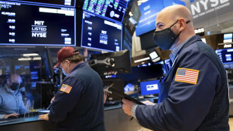 Traders work the floor of the New York Stock Exchange on Friday.