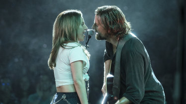Lady Gaga, left, and Bradley Cooper in a scene from A Star is Born.