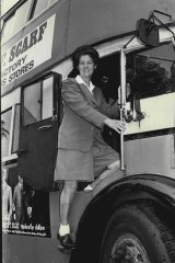 June Lusk climbs into the driver's cabin of a double-decker bus for a driving lesson in 1970.