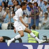 France's Raphael Varane, left, celebrates after scoring his side's opening goal against Uruguay.