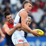 Alex Neal-Bullen tackles Patrick Cripps.