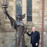 Bill Crews and one of only three replicas of the Statue of Democracy outside the Uniting Church in Ashfield.