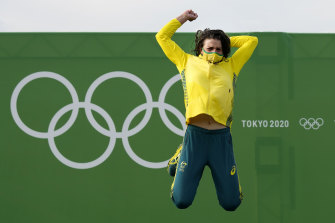 Jess Fox jumps for joy after receiving her gold medal.