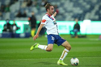Newcastle's Angus Thurgate shoots on goal.