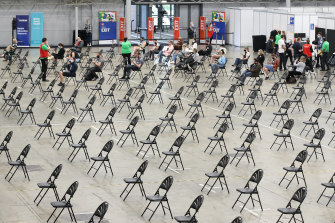Chairs set out for people to wait after receiving a vaccine dose inside the Brisbane Convention and Exhibition Centre hub, which opened this month.