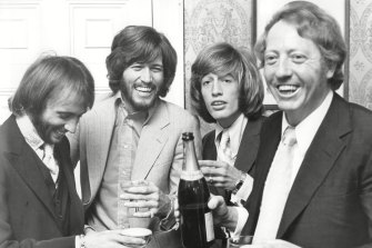 Frrom left, Maurice, Barry and Robin Gibb with their manager Robert Stigwood in a still from Bee Gees: How Can You Mend a Broken Heart?