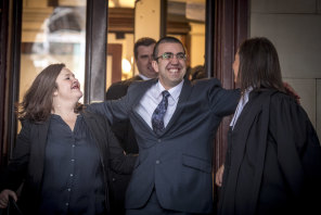 Faruk Orman, flanked by his lawyers, walks free from the Supreme Court in July 2019.