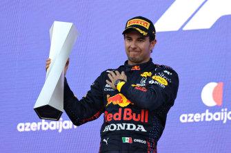 Sergio Perez celebrates his win.