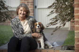 Michele Adair, pictured with her dog Bella, helped expand the Smith Family's scholarships for disadvantaged kids, inspired by her own family's struggles.