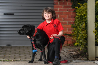 Max Creighton, 8, and his dog Ruby.