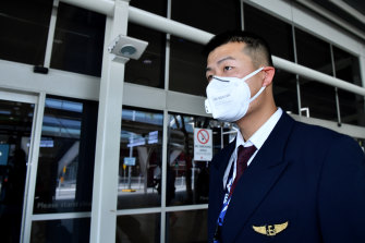 China Eastern Airlines flight crew wear protective masks on arrival at Sydney International Airport on Thursday.
