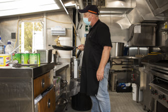 Local chef Sam cooks up breakfast for the police officers at Cann River.