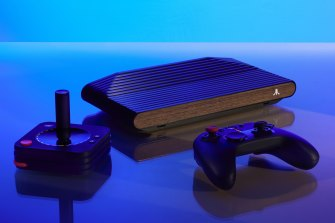 The Atari VCS evokes the original look of the 2600 with a wood front panel.