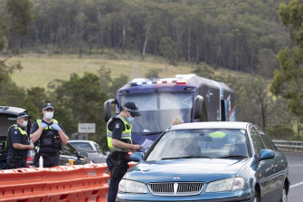 Victoria Police check for permits at a road block at Genoa on the Victorian border.