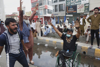 Supporters of Tehreek Labbaik Pakistan block a road and shout slogans protesting the arrest of their party leader Saad Rizvi in Lahore on Sunday.