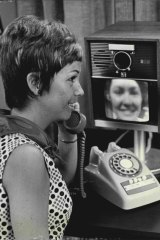 "Mrs. B. Simpson of Manly Vale tries a ""see-as-you-speak TV telephone"" at the David Jones George Street store on October 21, 1969."
