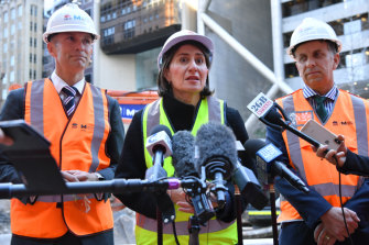 NSW Premier Gladys Berejiklian, flanked by Planning Minister Rob Stokes, left, and Transport Minister Andrew Constance, at the site of the new underground metro train station at Martin Place in Sydney on Wednesday.