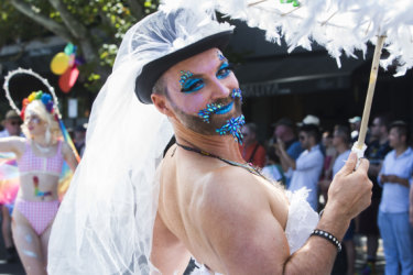 A participant in the 2019 Midsumma Pride March enjoys the vibe in Fitzroy Street, St Kilda.