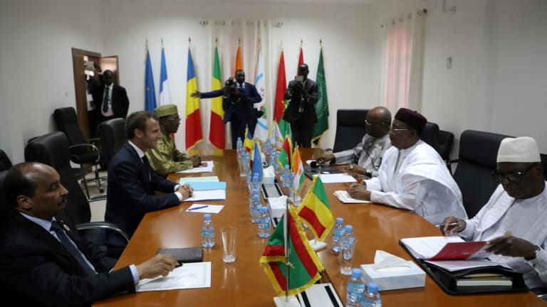 From left : Mauritania President Mohamed Ould Abdel aziz, France's Emmanuel Macron, Tchad's Idriss Deby, Burkina Faso's Roch Marc Christian Kabore, Niger's Mahamadou Issoufou and Mali's Ibrahim Boubacar Keita meet in Nouakchott, Mauritania, on Monday.