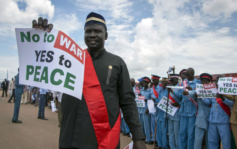 South Sudanese people hold peace signs as talks to end the five-year civil war got under way in June.