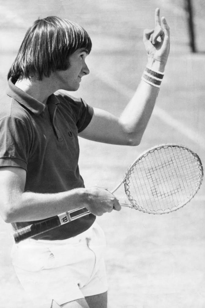 Connors makes gestures to the Australian Open crowd in 1974.
