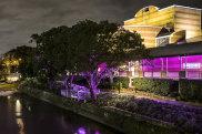 Riverside Theatre lit by night.