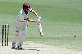 Failed audition: Joe Burns made just four against a Sri Lankan XI in Hobart.
