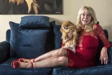 """""""We're all going to miss our treatments"""": Christa Billich at home with her dog, Charlie."""