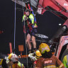 Rescue mission frees man trapped in toppled container forklift