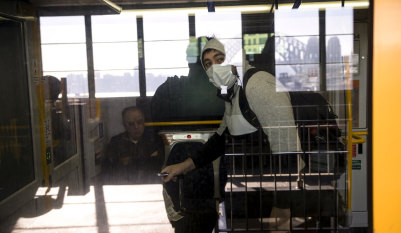 Calls for face masks grow as restrictions ease on transport system