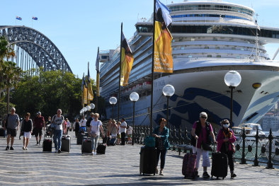 Cruise ship passengers disembark from the Ruby Princess at Circular Quay in Sydney on Thursday, March 19.