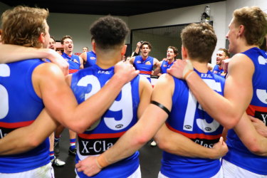 The Bulldogs sing the song after their win over the Giants.