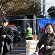 Residents move possessions out of Mascot Towers after an engineer's report has said the block may be moving downward.