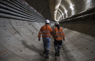 Abdalah El Sayed and engineer Jaime Cheuk walk down the Sydney metro tunnel.