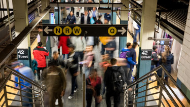 Commuters exit a Times Square subway station in New York last week. More than 64 million passengers go through the station annually.
