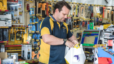 Paul Charlton from Browns Plains Hardware loads up a Wing delivery package.